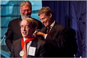 alan-kruger-inducts-larry-bartels-as-academy-president-douglas-massey-looks-on.299.201.s