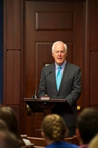 Senator John Cornyn (T-RX) welcomes audience to criminal justice reform briefing.